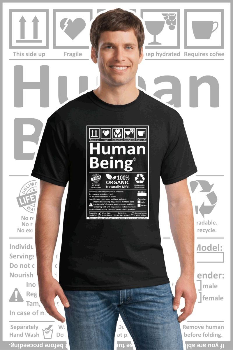 Male wearing a black printed T Shirt with a black design of a Human Being label.