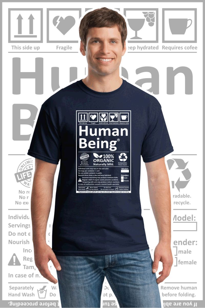 Male wearing a navy blue printed T Shirt with a black design of a Human Being label.